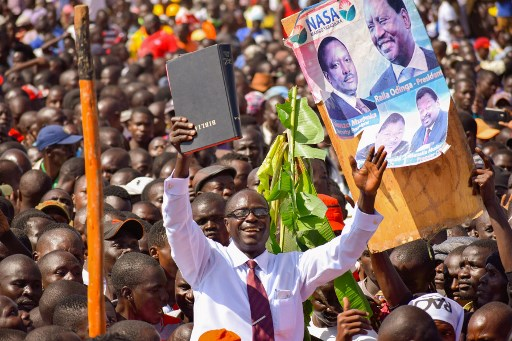 A supporter of Kenyan opposition party National Super Alliance (NASA) leader Raila Odinga gestures while holding a bible.