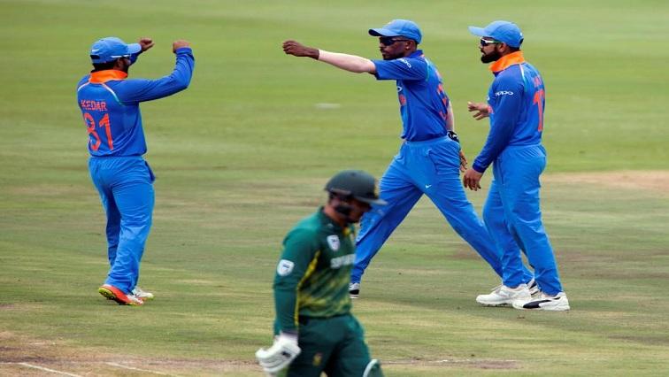 India's Kedar Jadhav, Hardik Pandya and Virat Kohli celebrate the dismissal of South Africa's Quinton De Kock.