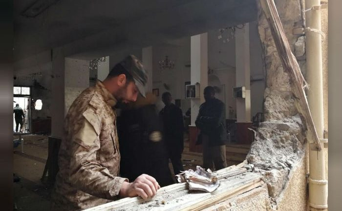 A member of the Libyan National Army inspects the damage following a twin bombing inside a mosque in Benghazi, Libya.