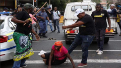 An ANC member is seen kicking a woman outside Luthuli House.