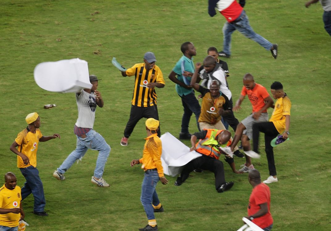 Kaizer Chiefs fans on the field.