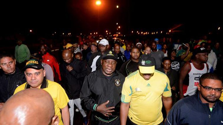 President Cyril Ramaphosa walking.
