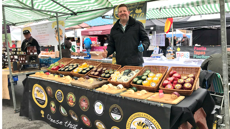 Man standing at his stall at the festival.