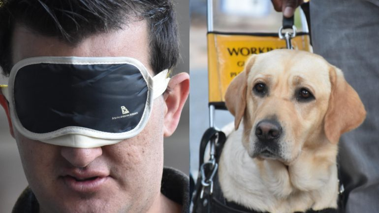Justin Kennerley with a guide dog.
