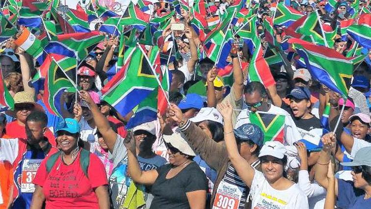 People walking with SA flags.