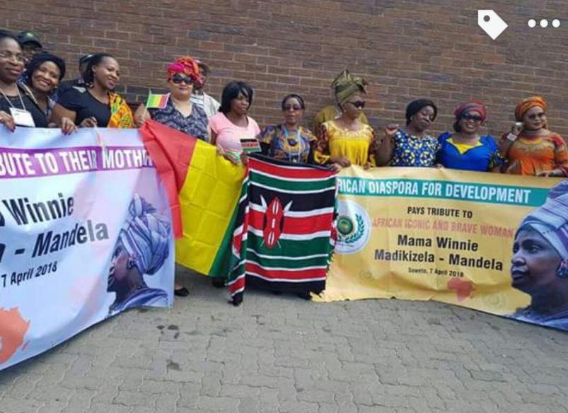 The African diaspora community visits Mam' Winnie's home.