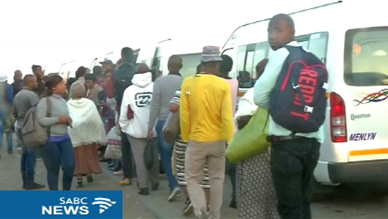 People waiting for taxis