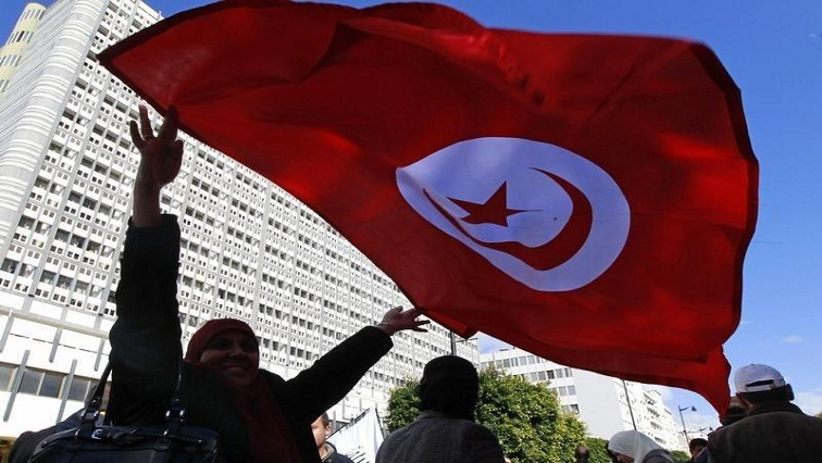 Party supporter waves Tunisian flag