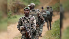 DRC soldiers holding guns.