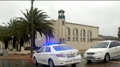 Police cars outside the mosque