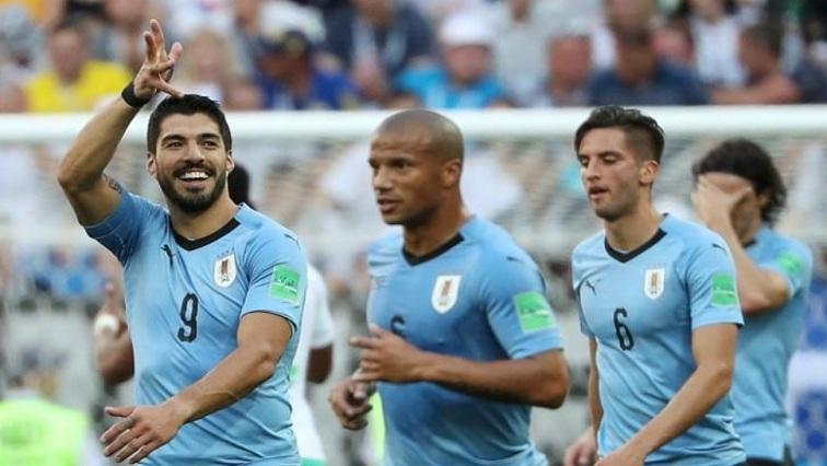 f724863c97b Uruguay s Luis Suarez celebrates scoring their first goal with team mates.