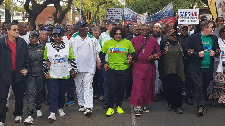 The marchers are walked to the Union Buildings to raise awareness against gender based violence.