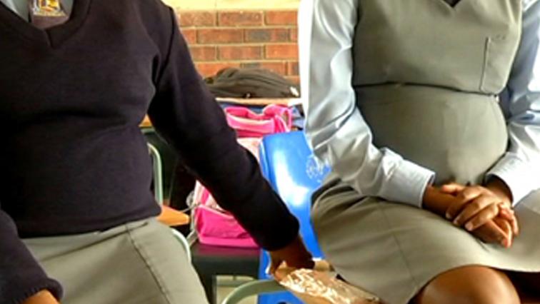 Pregnant learners in school uniform.