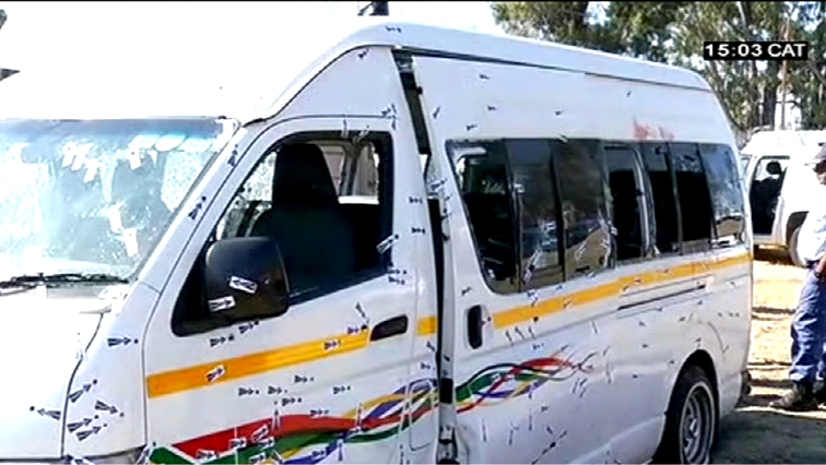 A taxi with bullet holes.