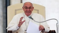 Pope Francis with a mic