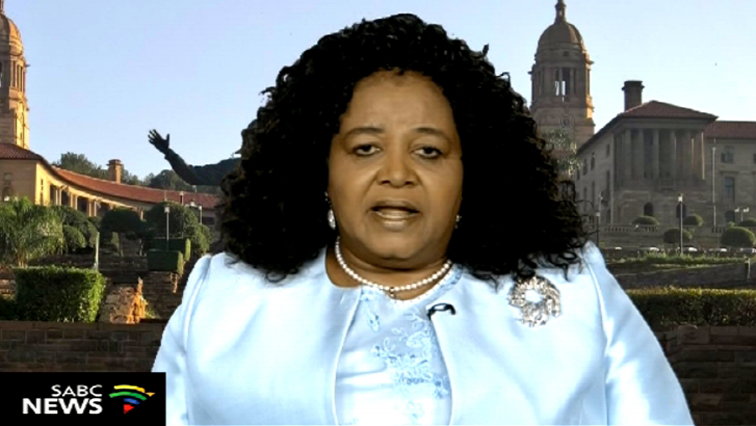 Edna Molewa wearing a blue top and jacket