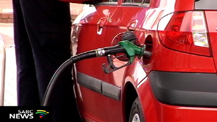 A red car at a petrol pump