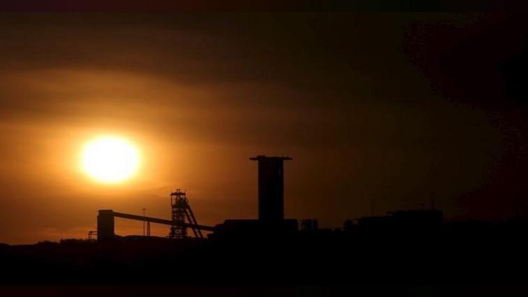 The sun sets behind a shaft