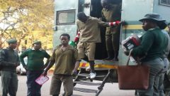 MDC supporters arrested last week stepping out of police truck