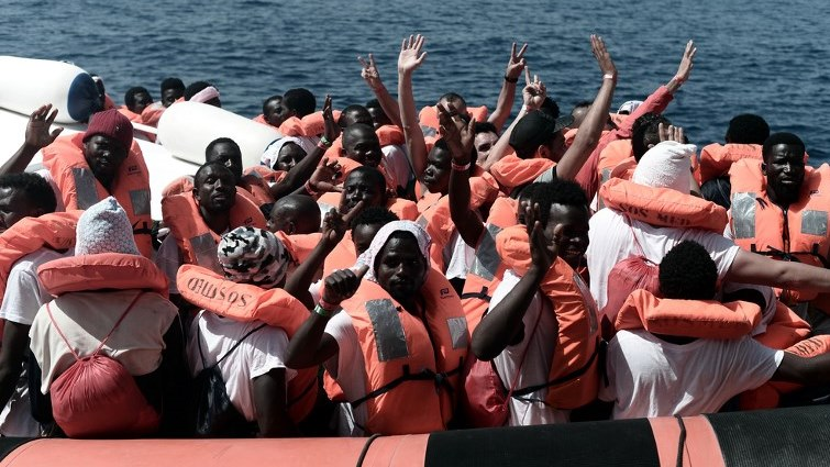 A boat full immigrants at sea