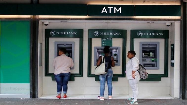 People oustide Nedbank ATMs