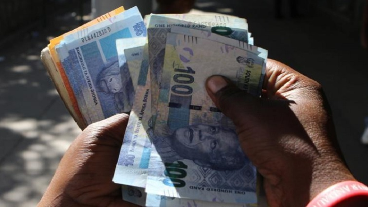 South African rands being counted