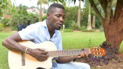Bobi Wine Playing a guitar