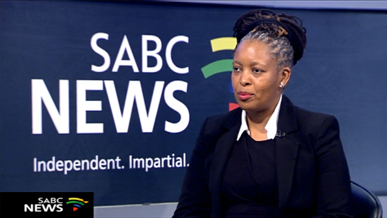 Dineo Mlomo speaking in an SABC interview