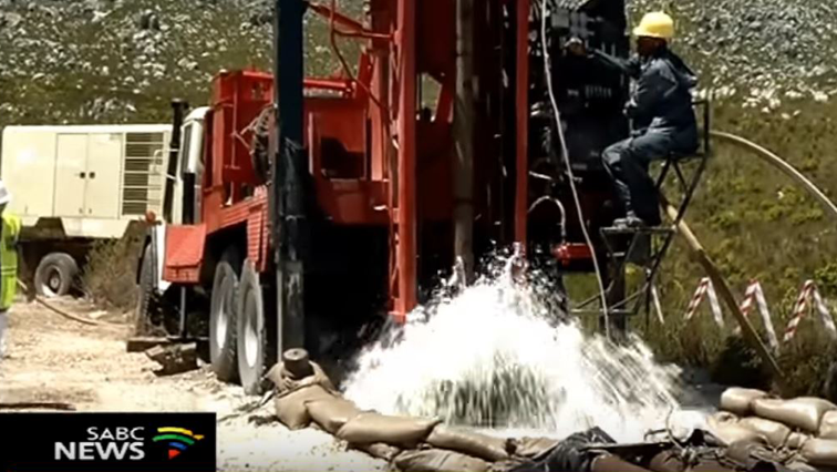 Drilling into the ground for water
