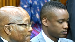 Former President Jacob Zuma sitting with his son Duduzane Zuma in court