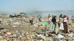 People at a landfill site