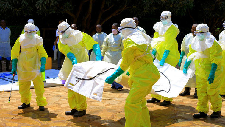 Health workers carrying a body