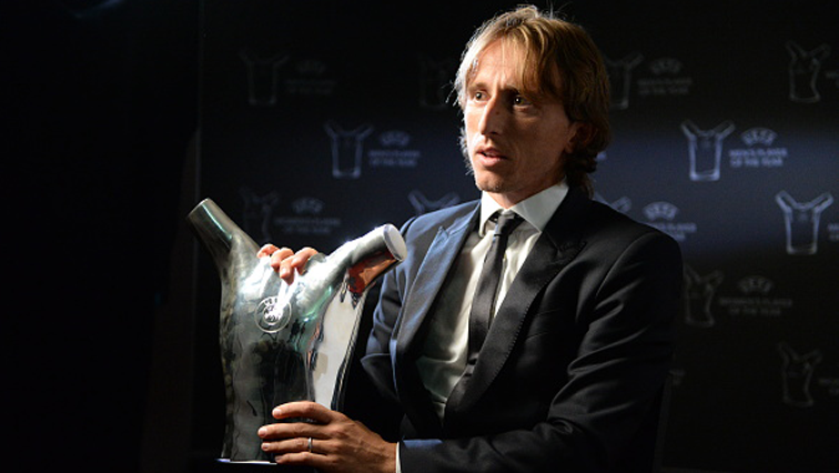 Real Madrid and Croatia midfielder Luka Modric holding the trophy.
