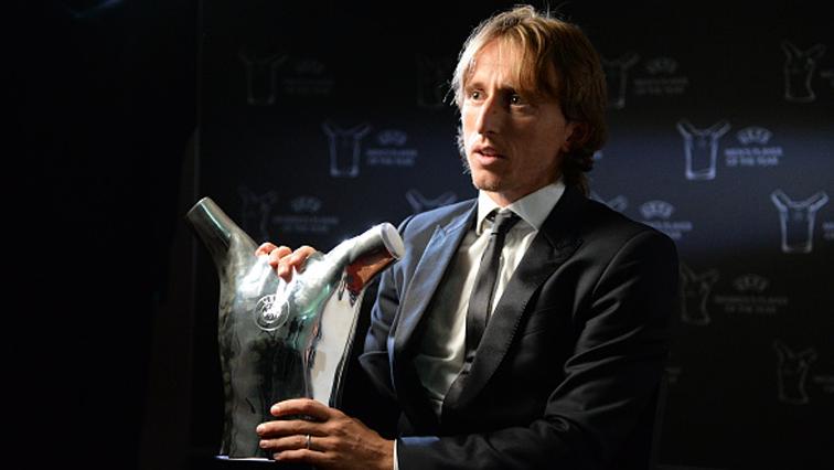 Real Madrid and Croatia midfielder Luka Modric holding the trophy.