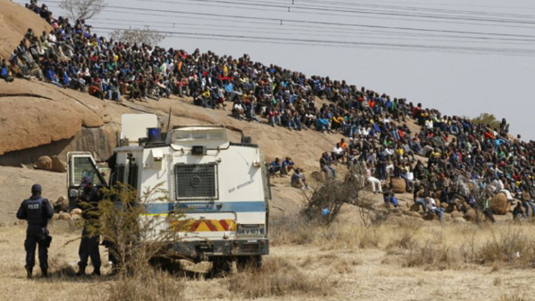 Marikana miners sitting on a hill in 2012 before the shooting