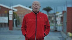 Mark Minnie wearing a red jacket