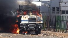 A police nyala was set alight during the protest on Tuesday.