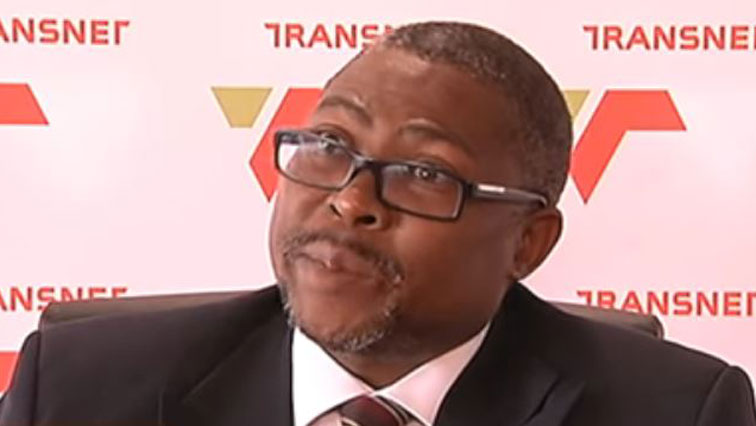 Siyabonga Gama wearing glasses and black suit