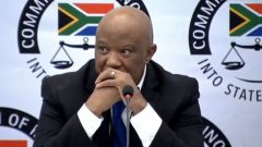 Mcebisi Jonas with hands clasped in front of his face