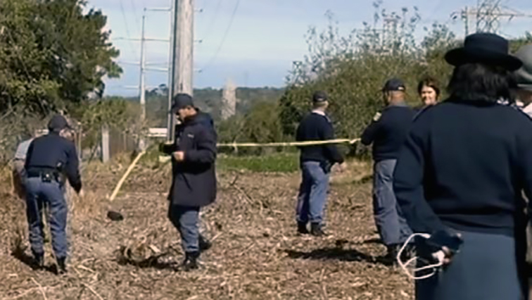 Police search for evidence at the scene of Minnie's murder.