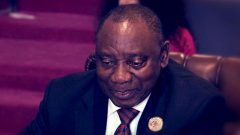 President Cyril Ramaphosa looking down.