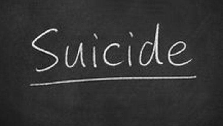 Suicide word written on board.