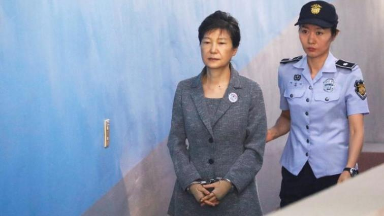Park Geun-hye handcuffed by police officer