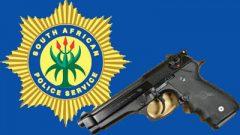 SAPS badge and a gun