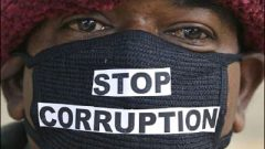 A man with a mouth mask written stop corruption