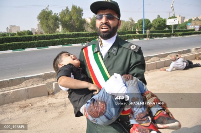 A man carrying a child
