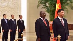 President Cyril Ramaphosa standing with Xi Jingpin