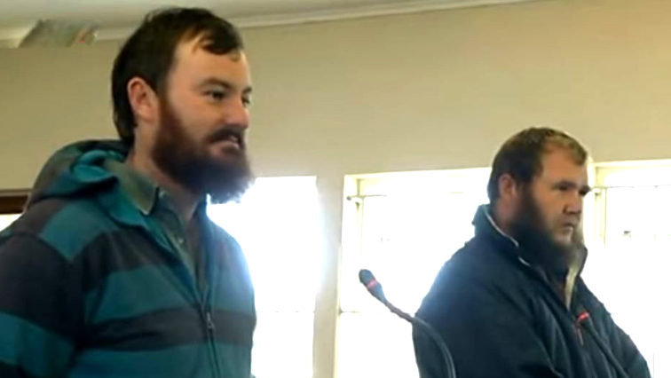 Pieter Doorewaard and Phillip Schutte standing in court