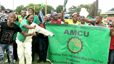 Amcu members holding a banner