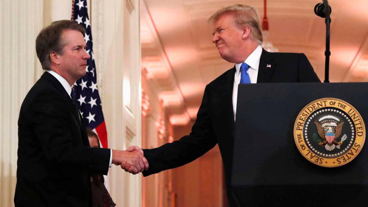 Donald Trump shakes hand with Brett Kavanaugh.